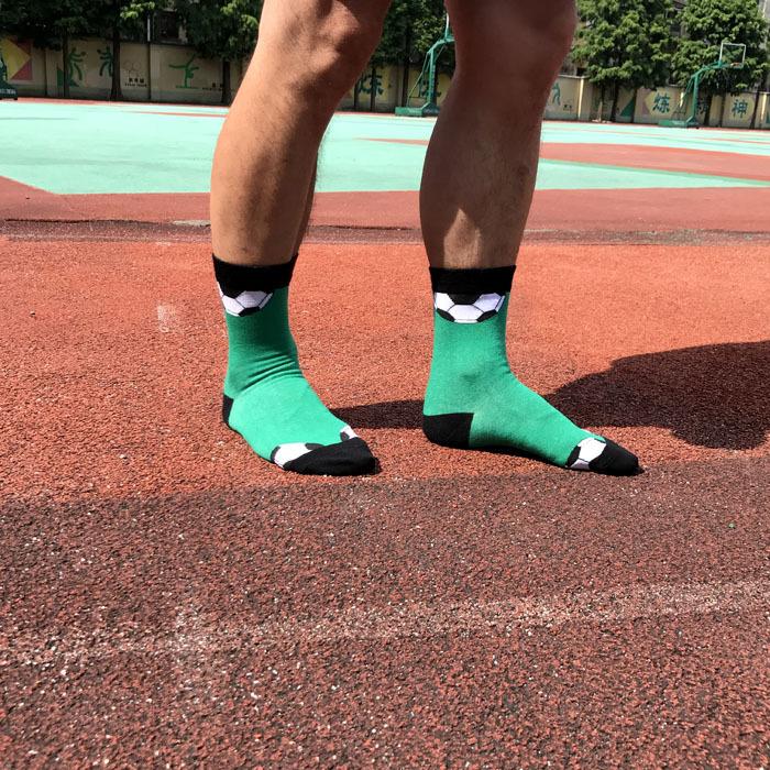 Green football patterned athletic crew socks for men-1